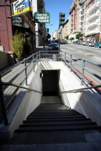 The iron-railed stairs that lead down to Stockton St.