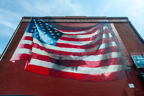 """Our Flag Unfurled"" by Meg Saligman on the south side of Building B."